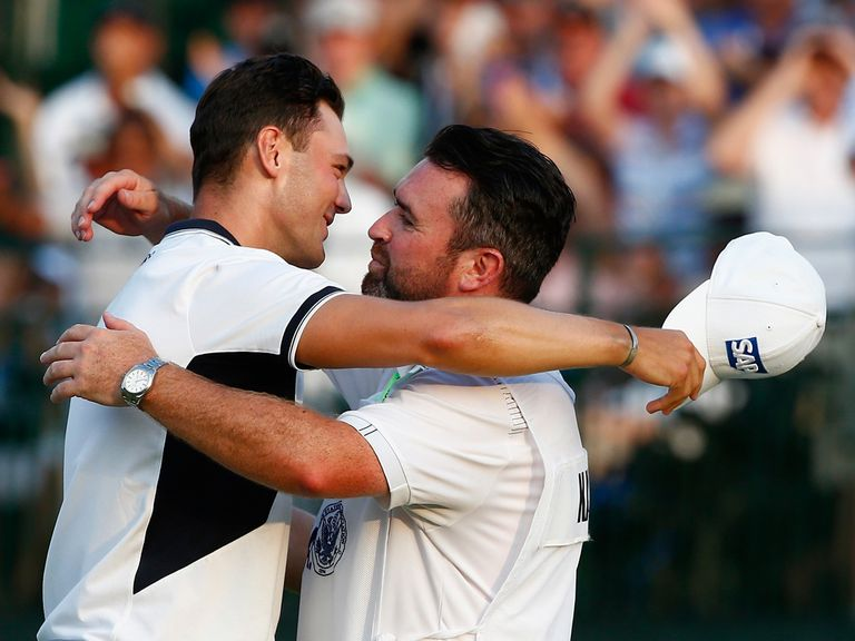 Martin Kaymer celebrates with caddy Craig Connelly