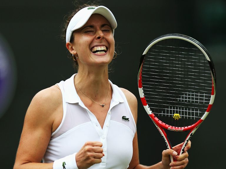 Alize Cornet celebrates after winning her third round match against Serena Williams