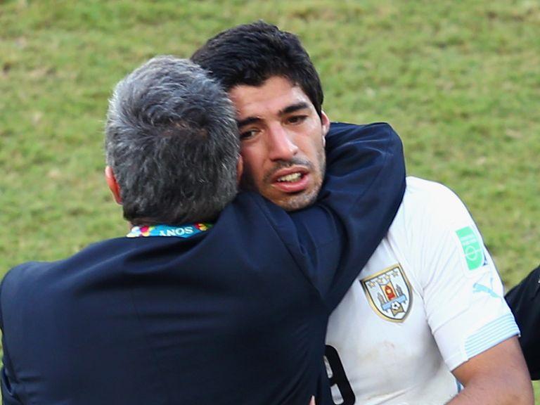 Uruguay manager Oscar Tabarez hugs Luis Suarez