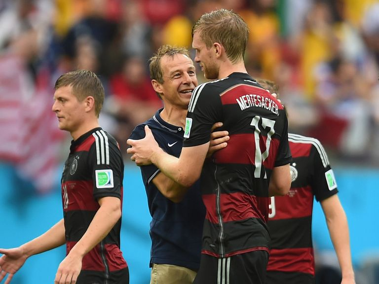 USA head coach Jurgen Klinsmanncongratulates Per Mertesacker