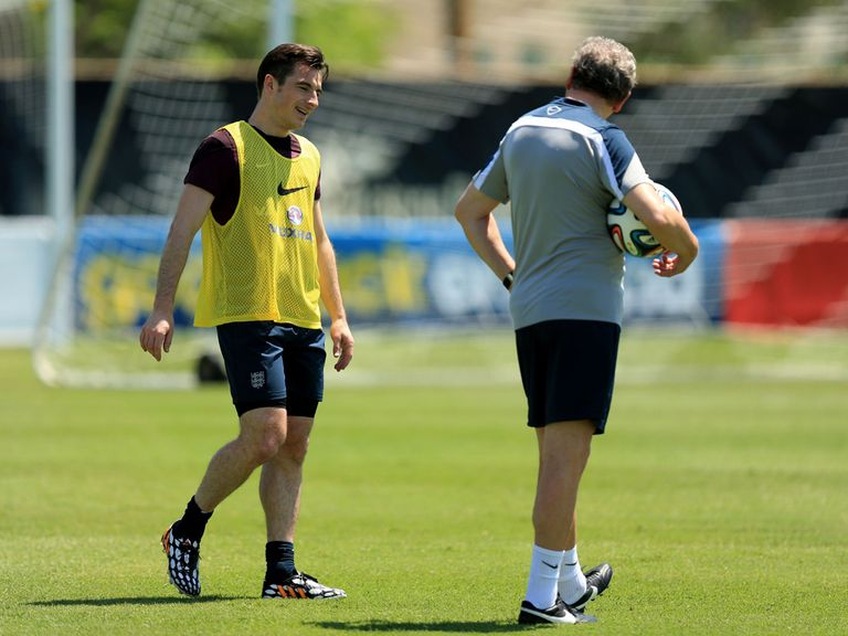 Leighton Baines and Roy Hodgson during England training