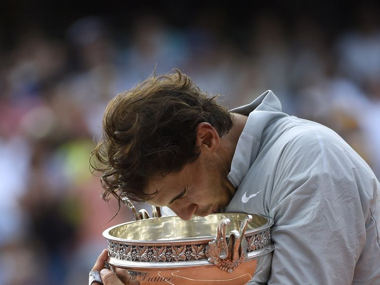 Nadal holds the trophy after winning his ninth French Open title