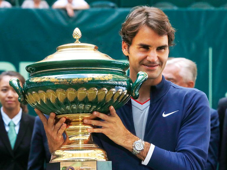 Roger Federer celebrates after beating Alejandro Falla in Halle