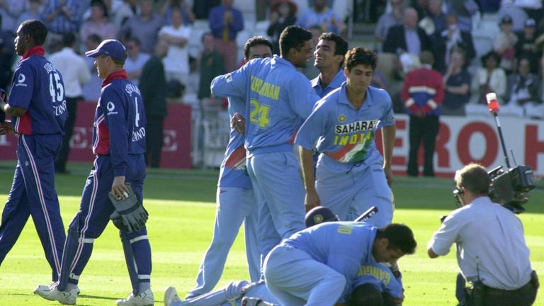 India's players leap all over Mohammad Kaif after his game-winning 89