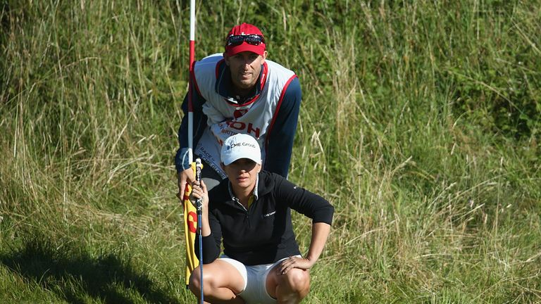 America's Mo Martin and her caddie line up a putt at Royal Birkdale