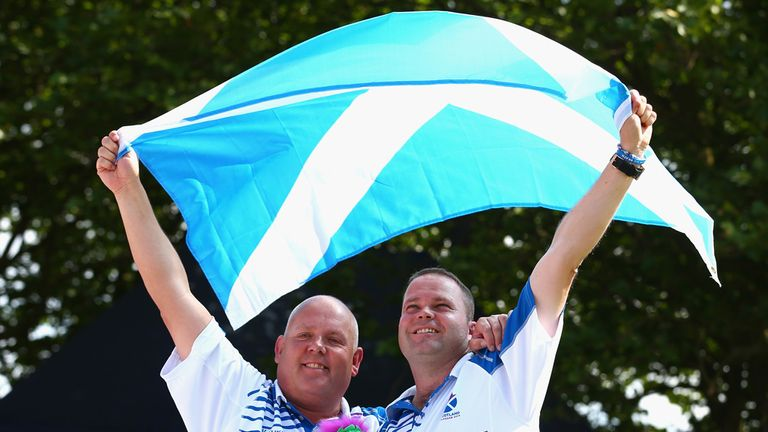 Alex Marshall and Paul Foster clebrate winning lawn bowls gold for Scotland