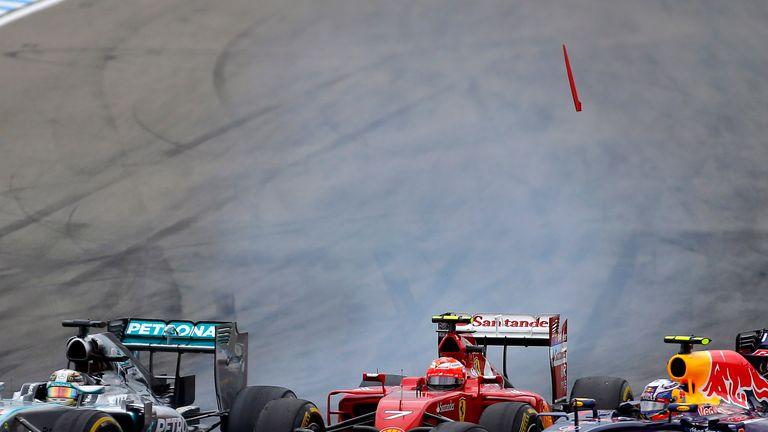 Lewis Hamilton, Kimi Raikkonen and Daniel Ricciardo battle