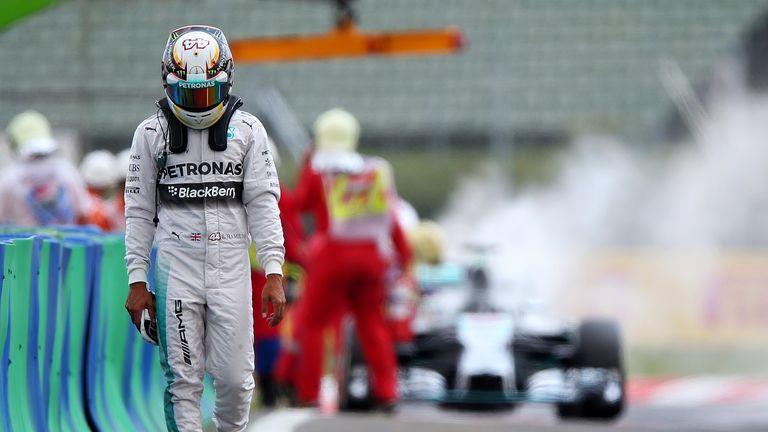 Lewis Hamilton walks away from his burning car