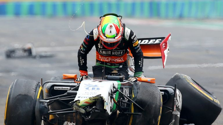 Sergio Perez crashed heavily into the pitwall