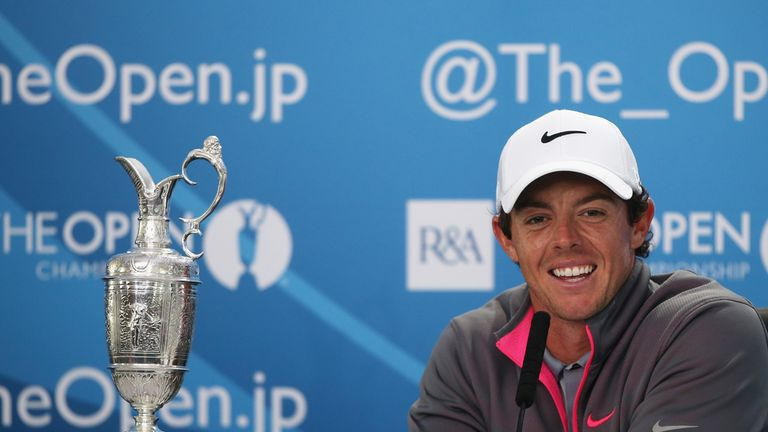 Rory McIlroy is all smiles as he poses with the Claret Jug after his Open victory at Hoylake