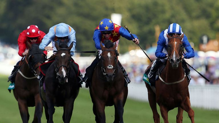 Es Que Love (centre), ridden by Adam Kirby - it was this ride that cost him dearly at the BHA.