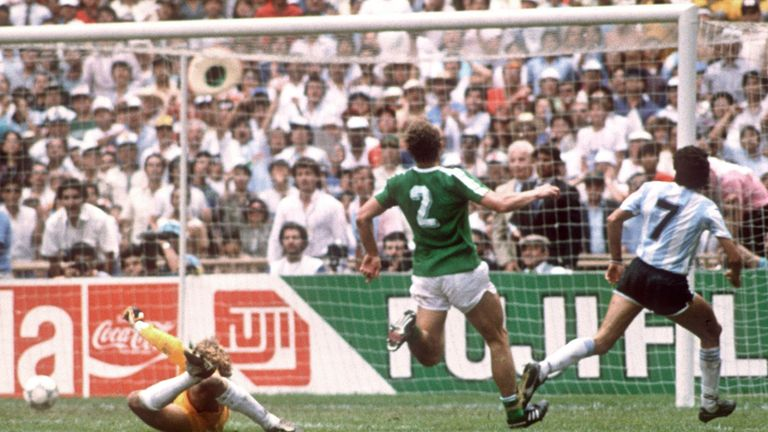 Jorge Burruchaga beats West Germany goalkeeper Toni Schumacher to score the winner