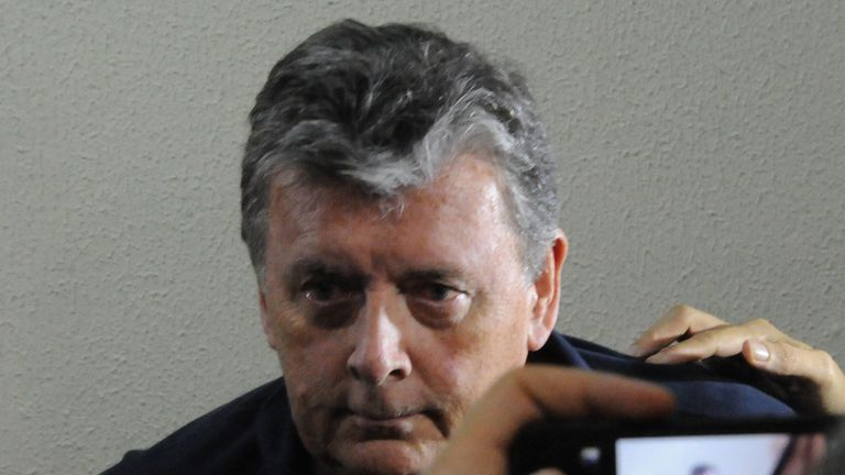The CEO of Match Hospitality, Raymond Whelan, sits at a police station in Rio de Janeiro after being arrested