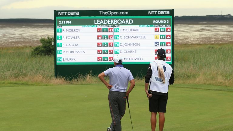 Rickie Fowler looks at the leaderboard at the Open