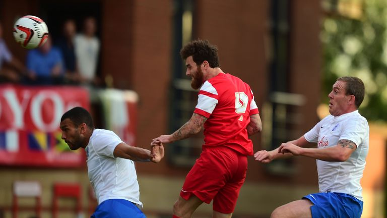 Leyton Orient's Romain Vincelot (centre) scores the opening goal past QPR's Steven Caulker (left) and Richard Dunn (right), friendly