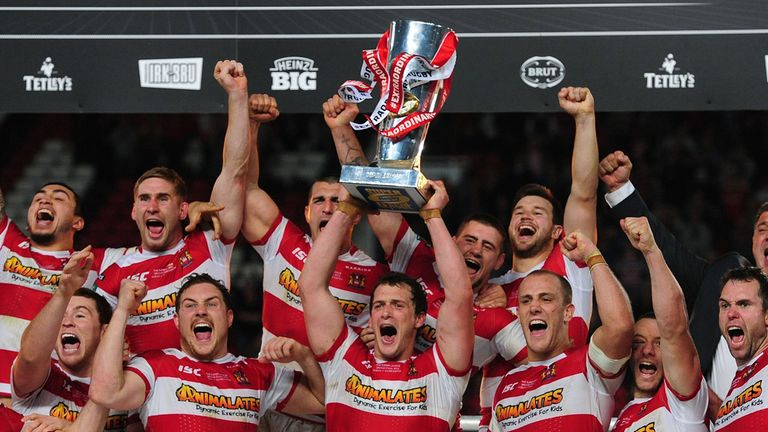 Wigan Warriors celebrate after winning Super League's Grand Final in 2013.