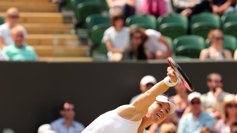 Romania's Simona Halep serves to Kazakhstan's Zarina Diyas during their women's singles fourth round match