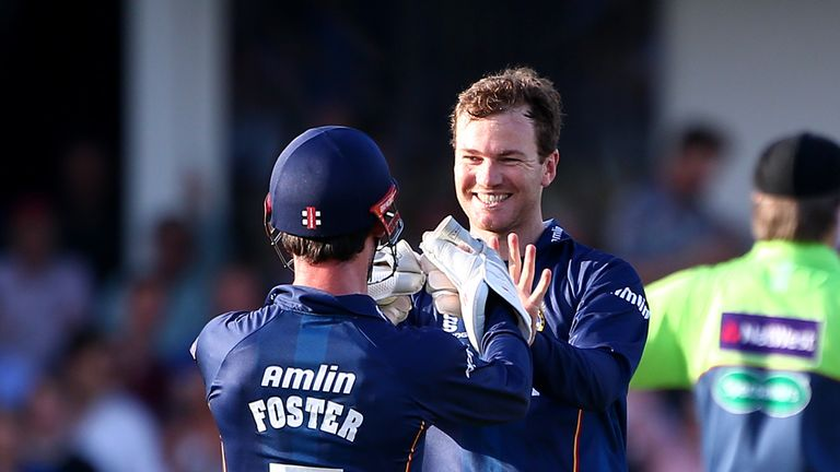 Tim Phillips: Essex spinner celebrates with James Foster after taking the wicket of Surrey's Kevin Pietersen