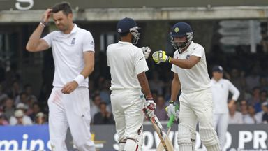 Anderson scratches his head during Jadeja and Kumar