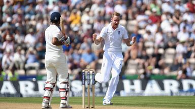 Stuart Broad: England seamer celebrates the wicket of Cheteshwar Pujara