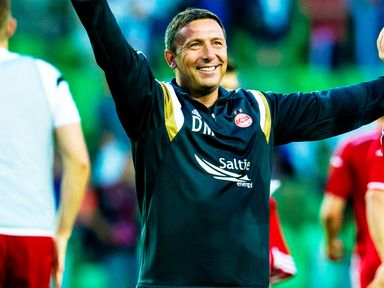 Derek McInnes celebrates his team's win in Groningen
