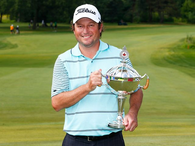 Tim Clark holds the trophy after winning the RBC Canadian Open