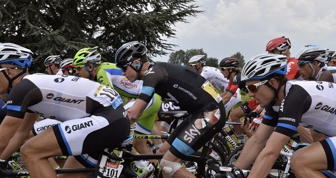 Chris Froome suffered cuts and grazes to his shoulder, hip and knee in a crash on stage four