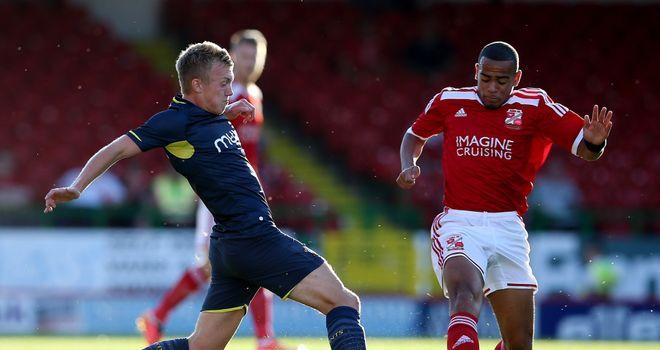 James Ward-Prowse (l): Tries to skip past Louis Thompson