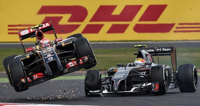 Pastor Maldonado gets airborne alongside Esteban Gutierrez