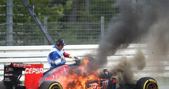 Daniil Kvyat's car bursts into flames
