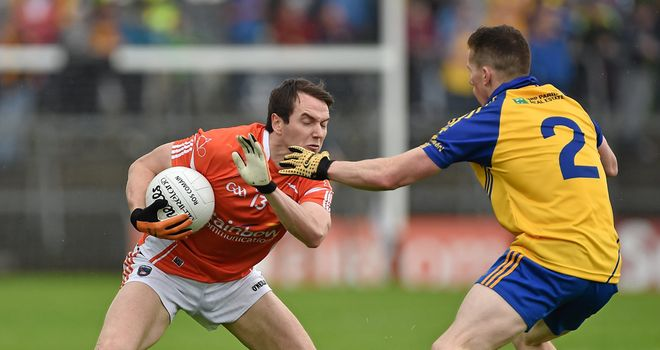 Armagh forward Tony Kernan is tackled by Seanie McDermott