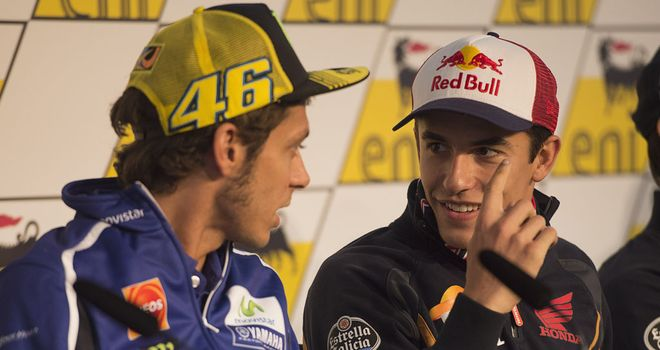 Marc Marquez (r) and Valentino Rossi chat during a press conference in Germany this week