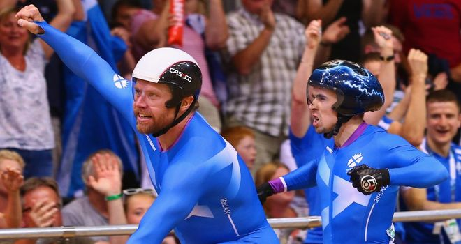 Neil Fachie and Craig MacLean celebrate winning their second gold medal of the Commonwealth Games