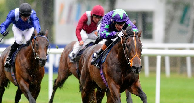 Richard Hughes guides Ivawood to a smooth success in the July Stakes