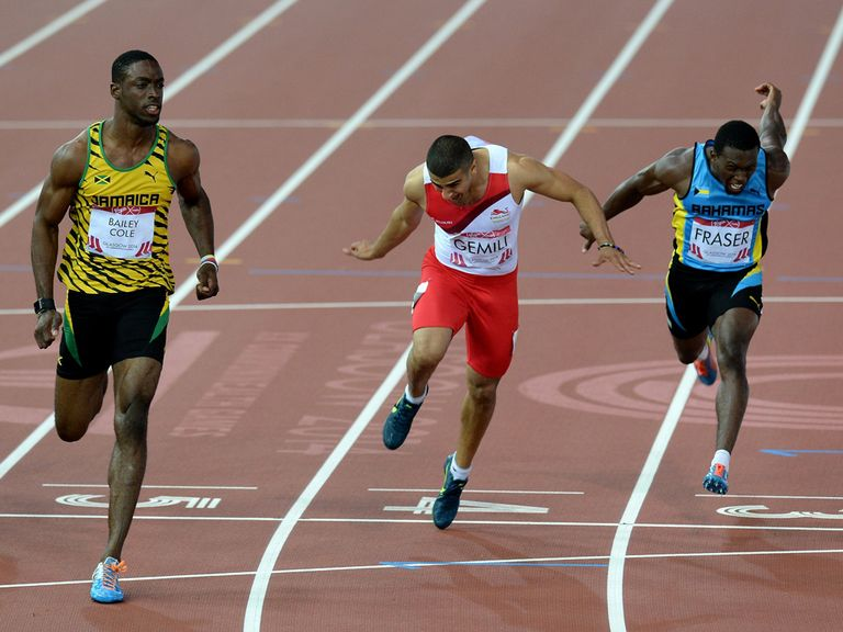 Jamaica's Kemar Bailey Cole (left) wins ahead of England's Adam Gemili