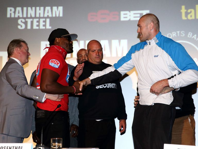 Dereck Chisora and Tyson Fury shake hands