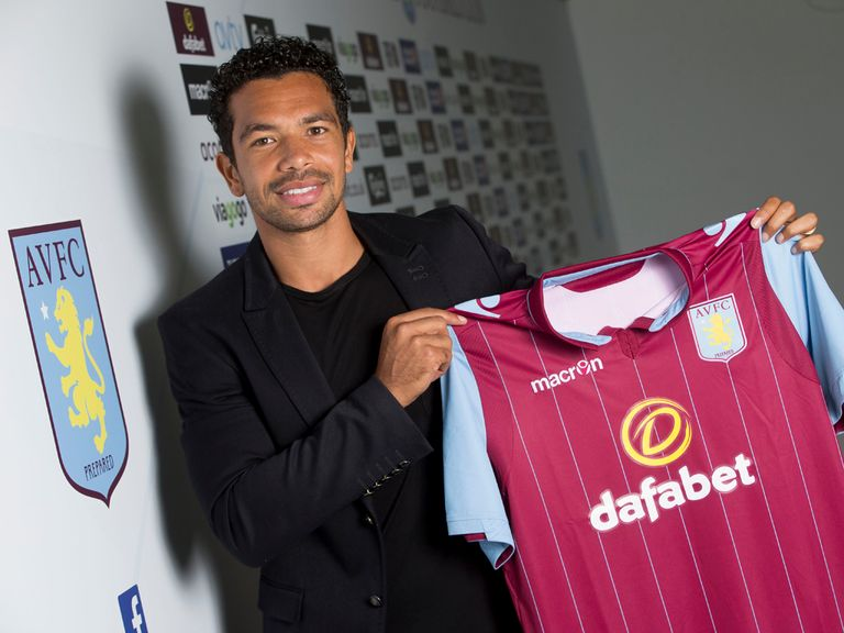 Kieran Richardson poses with his Aston Villa shirt