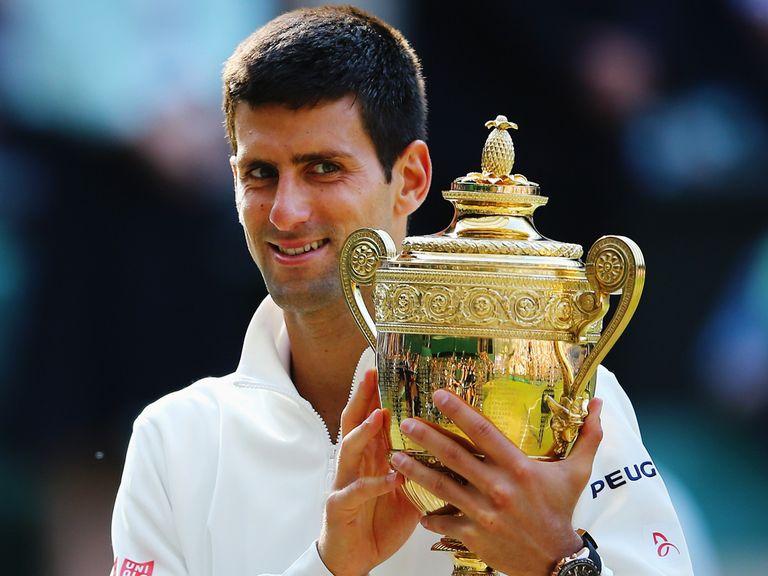 Novak Djokovic lifts the Wimbledon trophy for a second time