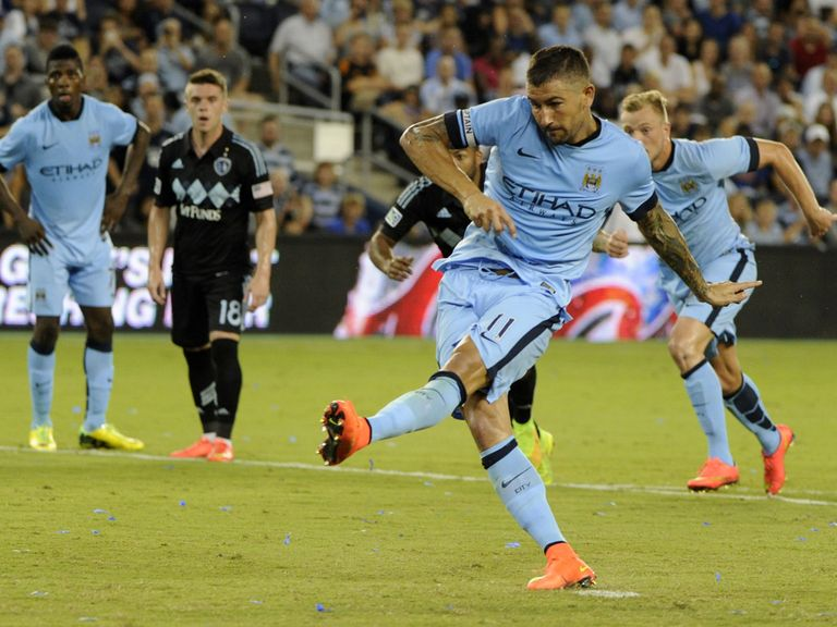 Aleksandar Kolarov scores from the spot for Manchester City