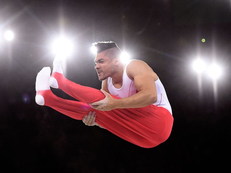 England's Louis Smith performs on the parallel bars