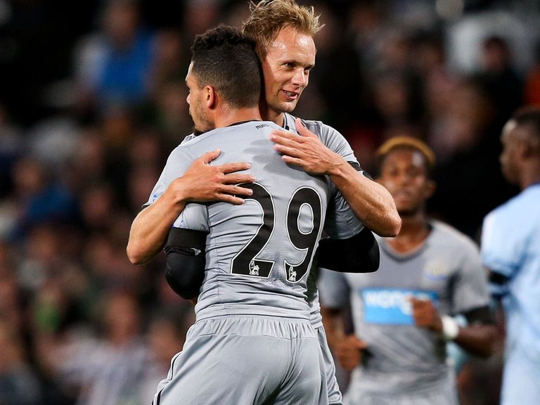 Siem de Jong celebrates his goal with Emmanuel Riviere