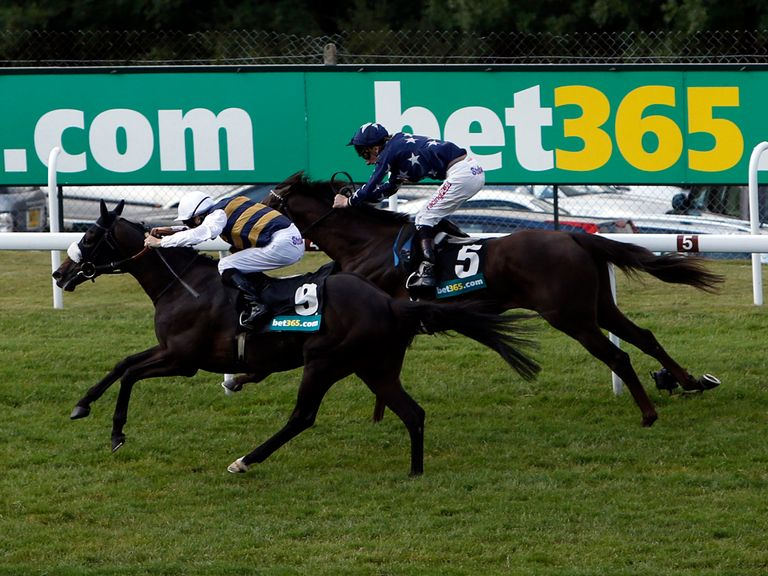 Van Percy (left) wins the Summer Stakes at Goodwood
