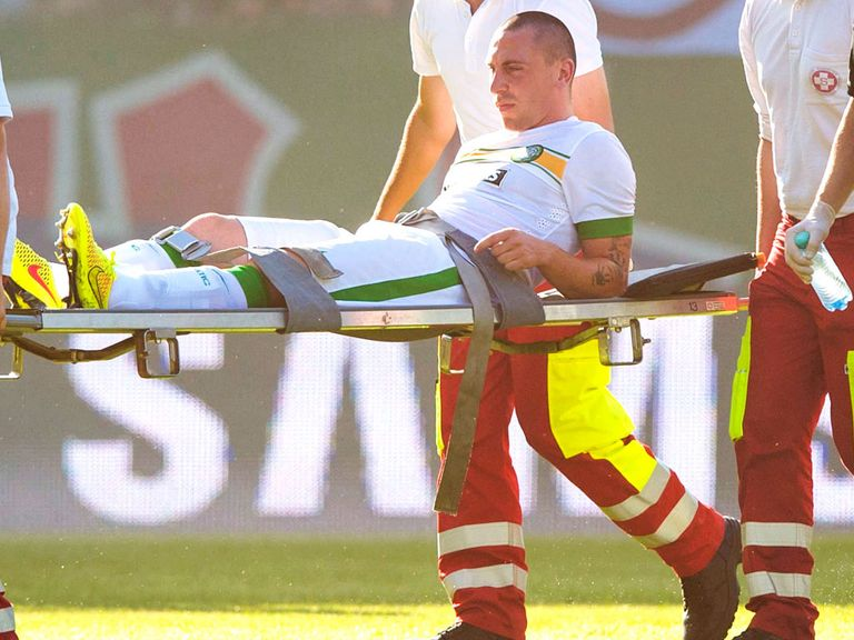 Scott Brown: Celtic skipper is carried off the pitch