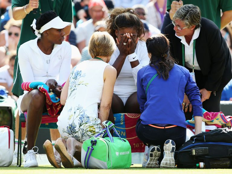 Serena Williams is attended to by medical staff at Wimbledon