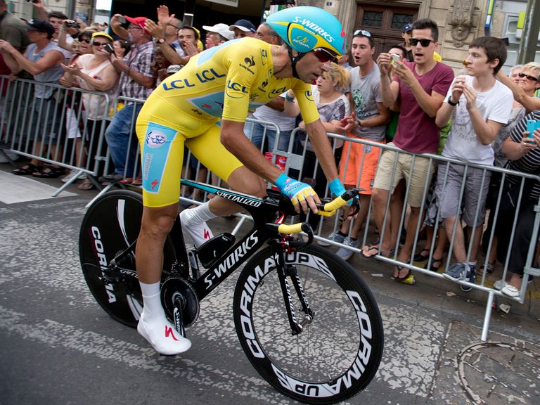 Vincenzo Nibali crosses the finish line and will win the Tour de France