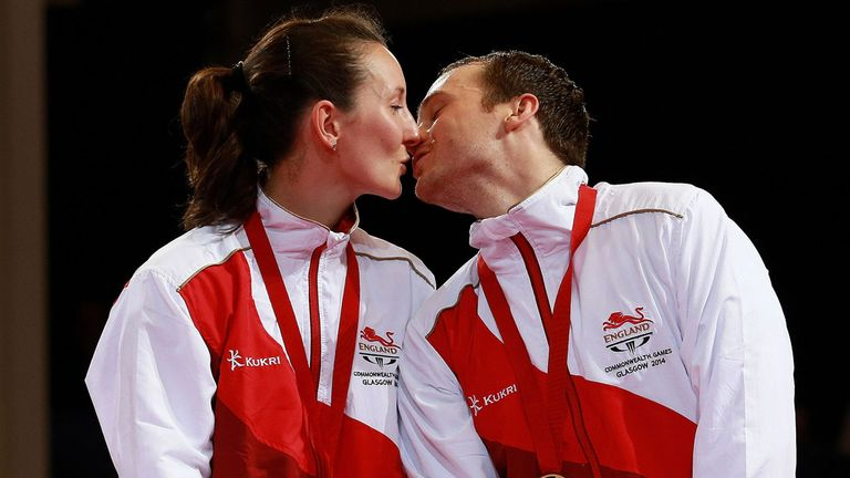 Golden kiss: Marital bliss for Joanna and Paul Drinkhall who celebrate winning the Commonwealth title