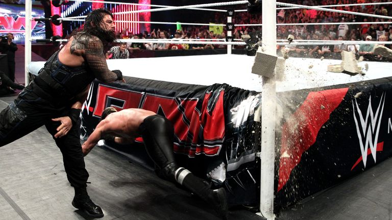 Roman Reigns narrowly misses hitting Seth Rollins with a cinderblock