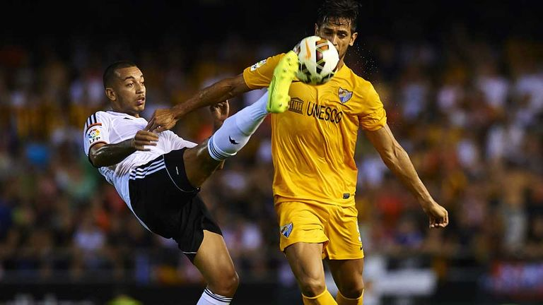 Ruben Vezo of Valencia competes for the ball with Roque Santa Cruz
