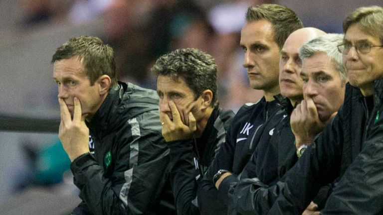 Celtic manager Ronny Deila and his dejected backroom team