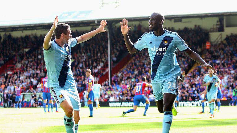 Carlton Cole (R): Celebrates with fellow goalscorer Stewart Downing
